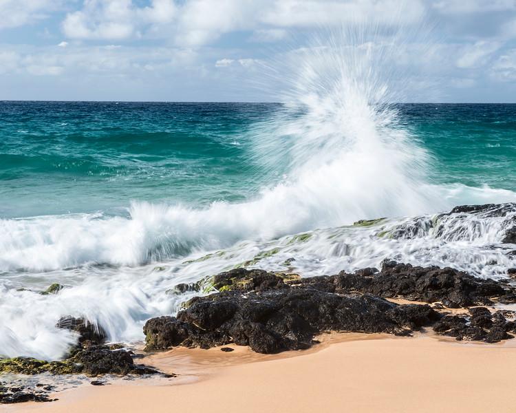 Wave crashes on Secret Beach, Kauai
