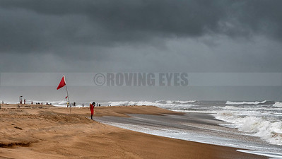 B21:The lifeguard pays homage to the sea before starting work in Calangute,Goa