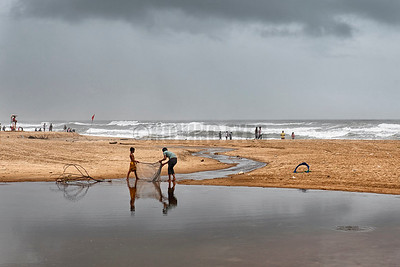 B22:Local kids fishing in the shallow tidal pond on the beach in Calangute,Goa