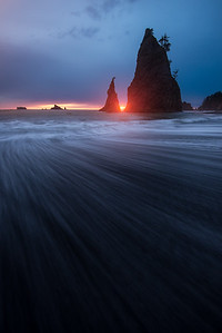 The last light shines through seastacks at Rialto Beach, WA