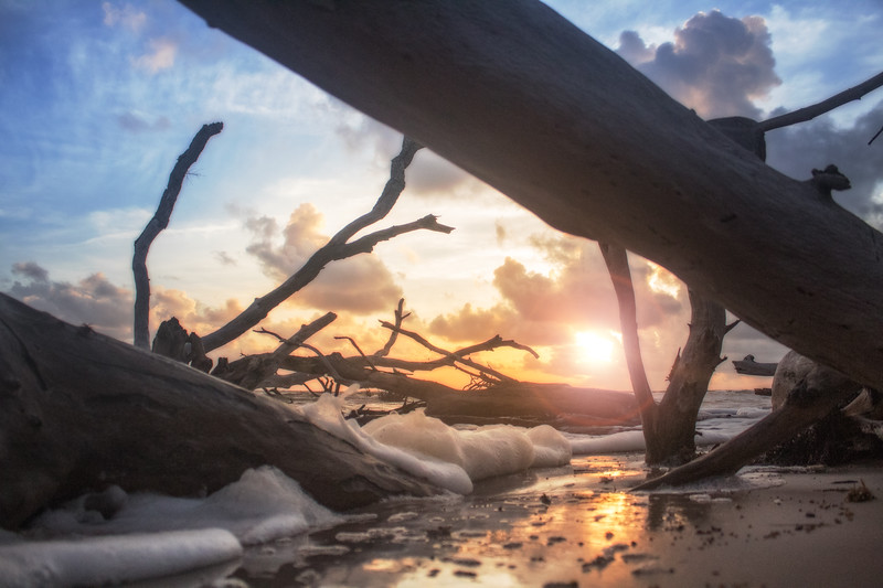 black rock beach florida ocean water sand long exposure sunrise driftwood golden hour colorful