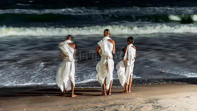 B14:Trainee monks from the temple of Lord Jagannath pay homage to the ocean as God on the beach of Puri,Odissa