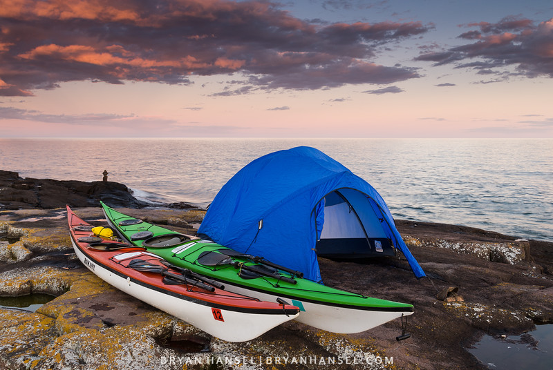 The sun sets of Lake Superior on a kayak campsite near Grand Marais, MN.