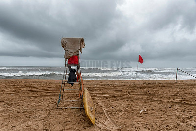 B23:A lonely lifeguard sits on his perch,guarding the empty beach on a monsoon day in Calangute,Goa