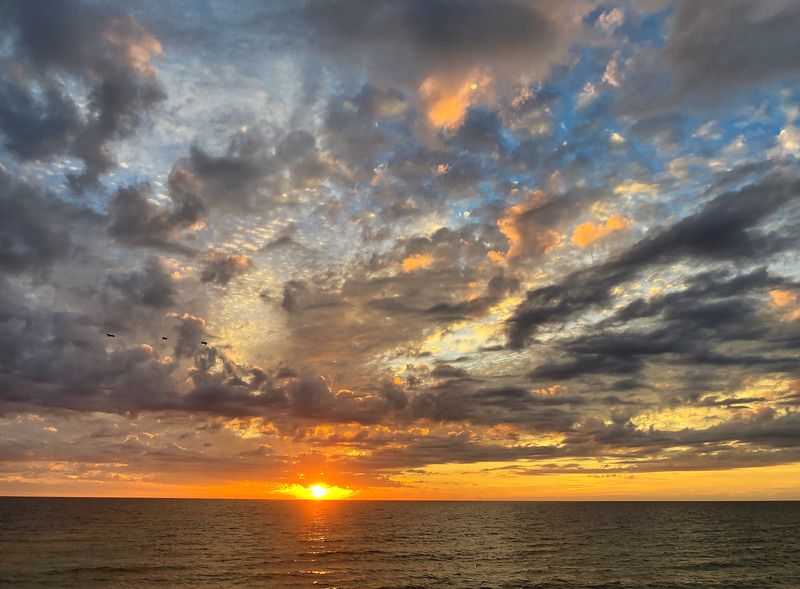 Sunset over the Gulf with dramatic cloud pattern