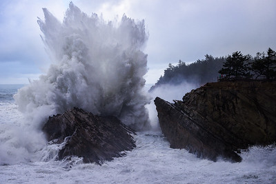 My wife and mother stand and watch as massive waves crash 200ft+ at Shore Acres State Park - Oregon
