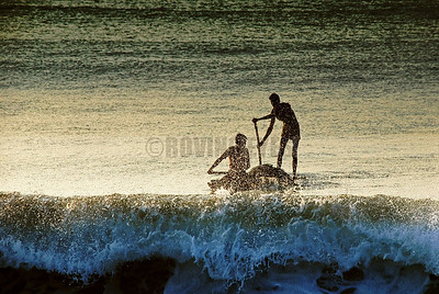 B1:Fishermen fighitng the waves while returning with their morning catch at Puri,Odissa