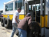 Bus Department Curator Tom Santarelli and John Arico load spare tires and rims onto our 4028, destined for Seashore.