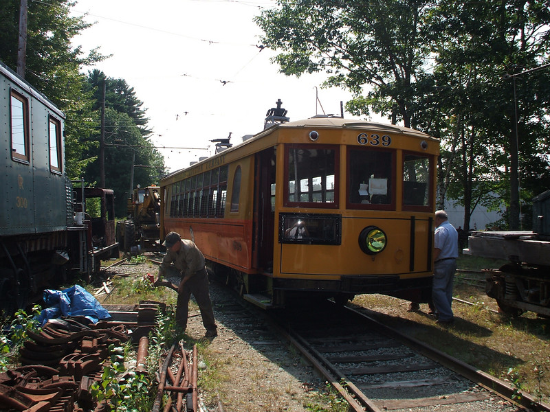 Wheeling curveside car 639 being moved over the pit to have its air brake system installed.