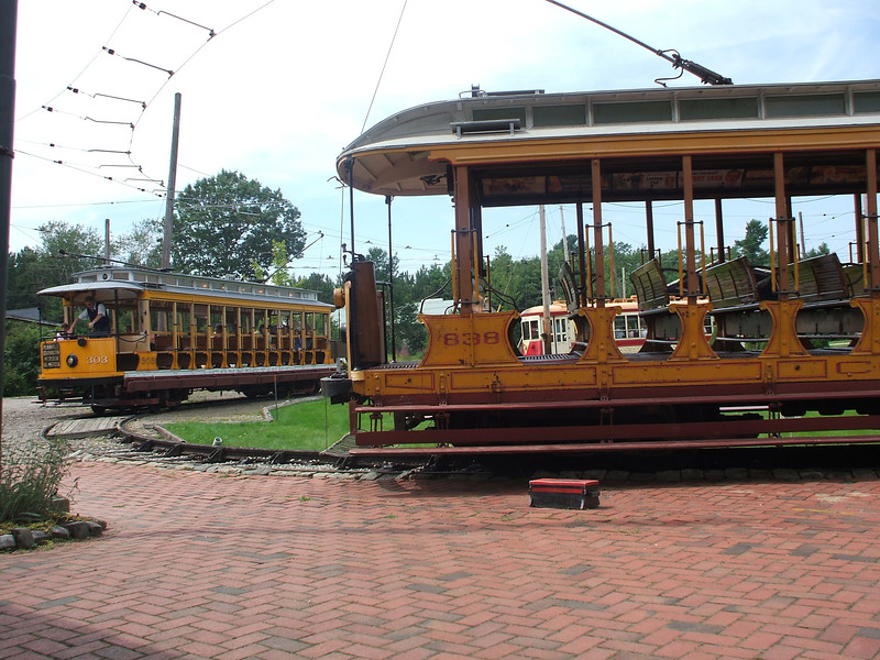 Connecticut open cars 303 (left) and 838 (right) sit awaiting their next trips in the Visitor's Center Loop