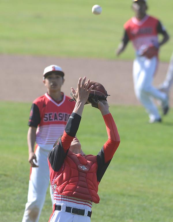 . Seaside catcher Daniel Sayre reels in a fly ball during baseball against Alvarez at Seaside High School on Thursday April 27, 2017.  (David Royal - Monterey Herald)