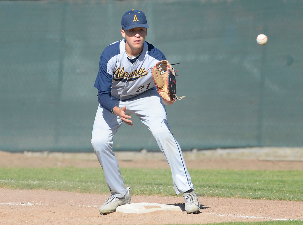 . Alvarez first baseman Juan Ceja reels in a throw for an out during baseball at Seaside High School on Thursday April 27, 2017.  (David Royal - Monterey Herald)