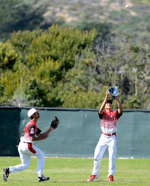 . Seaside fielder Cyrus Jackson, left, almost collides with center fielder James Davis as he reels in a fly ball during baseball against Alvarez at Seaside High School on Thursday April 27, 2017.  (David Royal - Monterey Herald)