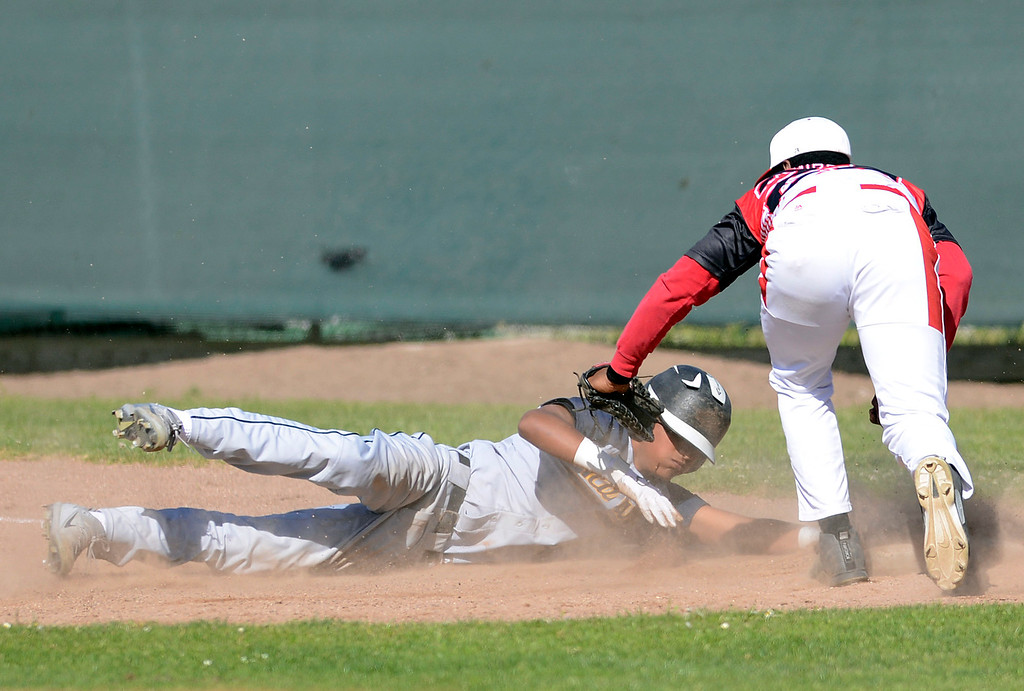 . Seaside first baseman Ray Huggins III tags out Alvarez\'s Isaiah Coria on a pick off during baseball at Seaside High School on Thursday April 27, 2017.  (David Royal - Monterey Herald)