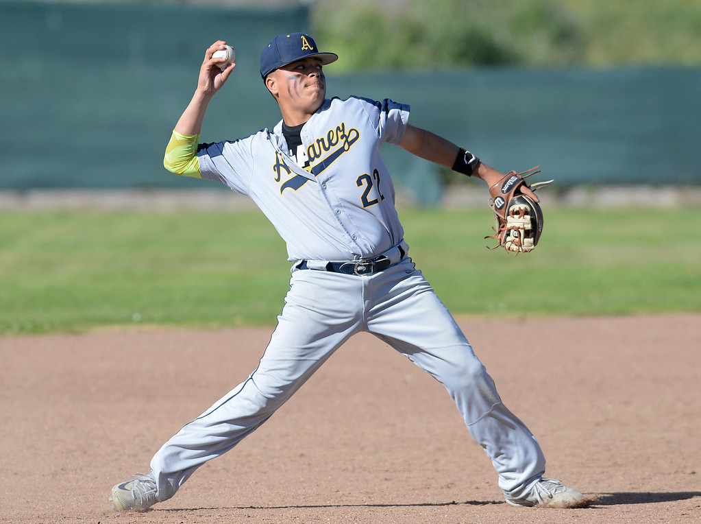 . Alvarez shortstop Fabian Herrera fields an infield hit during baseball at Seaside High School on Thursday April 27, 2017.  (David Royal - Monterey Herald)