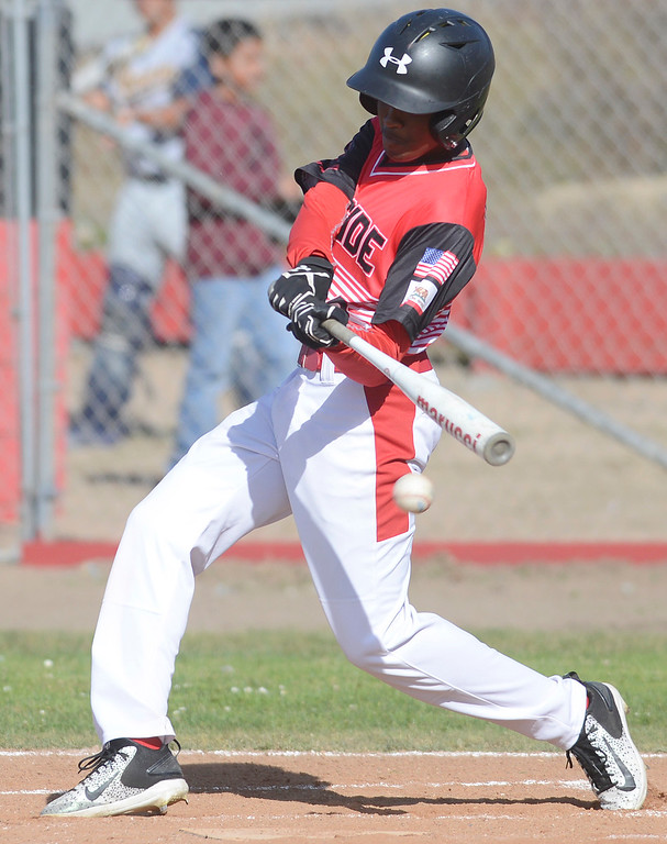 . Seaside\'s Omarr Wilson connects with a pitch during baseball against Alvarez at Seaside High School on Thursday April 27, 2017.  (David Royal - Monterey Herald)