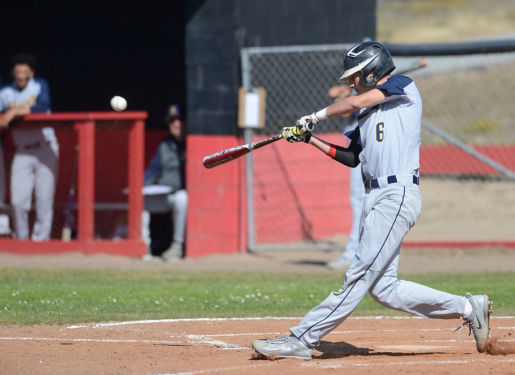. Alvarez\'s Danny Aguillon connects with a pitch during baseball at Seaside High School on Thursday April 27, 2017.  (David Royal - Monterey Herald)