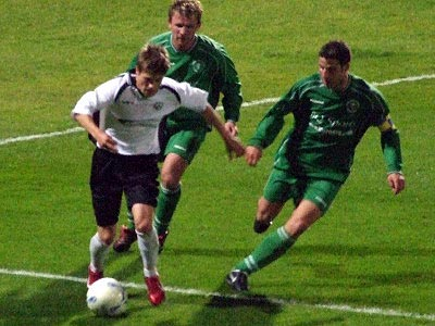 <center>Charlie Henry takes on two defenders</center>