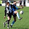 <CENTER>Scott Neilson tussles with a defender</CENTER>