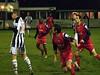 <CENTER>Ashley Fuller heads the ball on</CENTER>