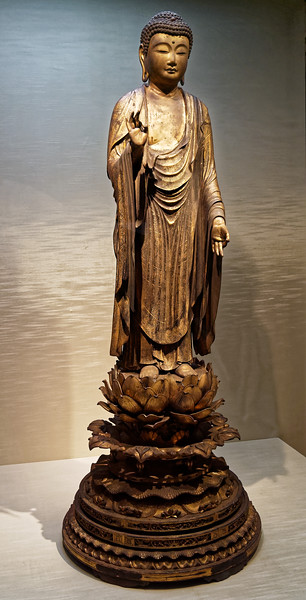 Standing Amida Nyorai (Amitabha), Wood with gold pigment, cut gold leaf, and inlaid crystal eyes. Kamakura period, 13th–14th century