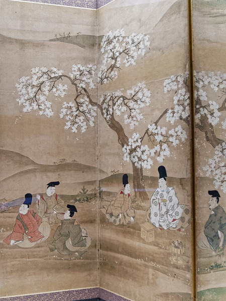 Cherry Blossom Viewing (detail of a folding screen), by Sumiyoshi Gukei (1631–1705). Edo period, 17th century. A prince at his villa, with attendants, enjoying composing poetry among cherry blossoms in a scene from <i>The Tales of Ise</i>