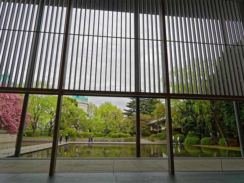 "Before leaving the museum grounds, a quick stop at the Gallery of Horyuji Treasures, designed by architect Yoshio Taniguchi, among whose other projects has been the redesign of the Museum of Modern Art, New York, completed in 2004. Of the building seen here, Taniguchi has written, ""Out of a desire to respect both the sublime works to be displayed and the natural setting, I made it my goal . . . to create on the site an environment of a kind that has become all too rare in present-day Tokyo, that is, an environment characterized by tranquility, order and dignity."""