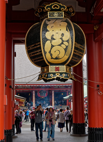 The enormous lantern is one of three that hang above the entry at the innermost of two large entrance gates to the temple grounds.