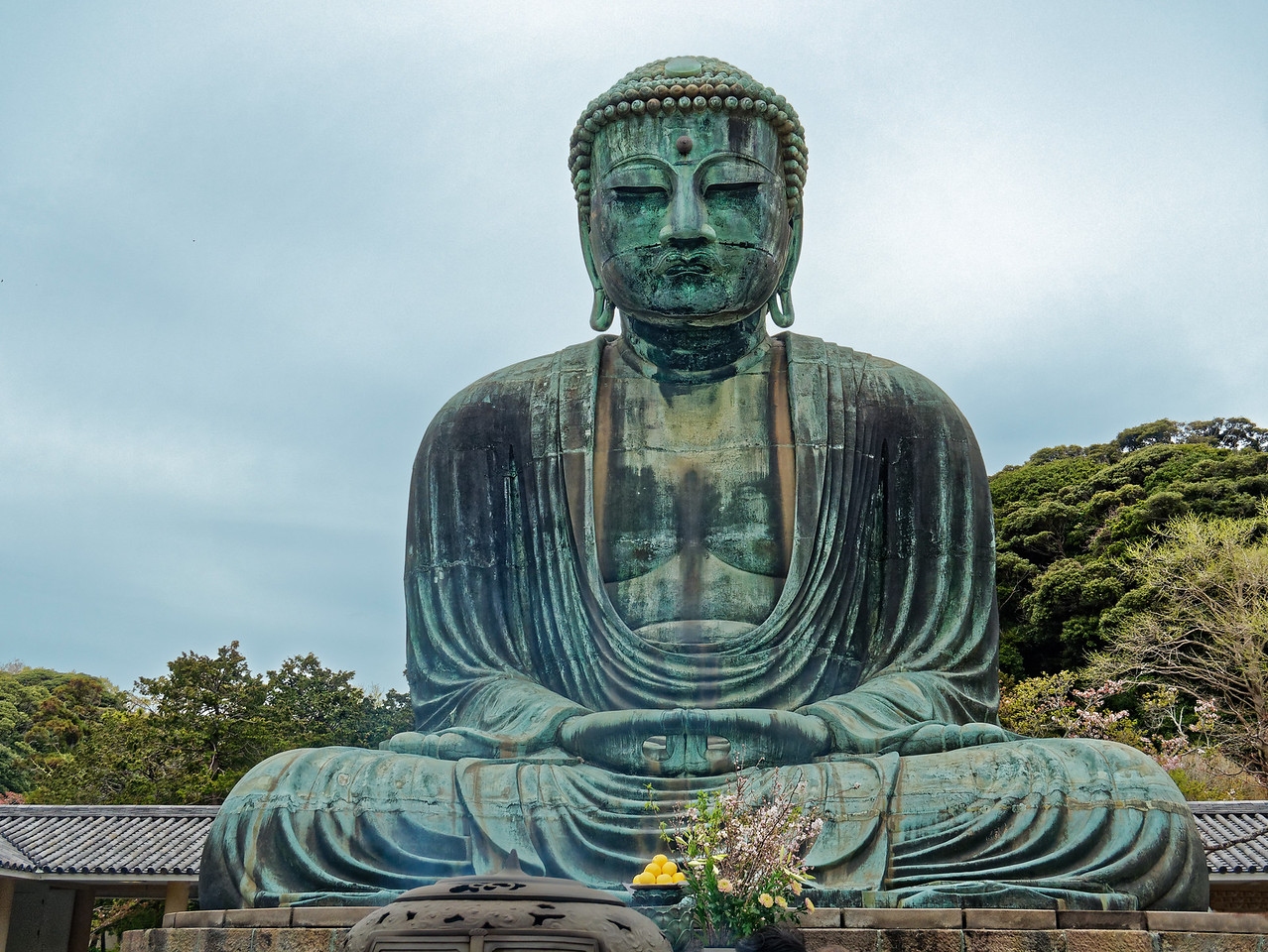 At one time the sculpture, over 40 feet in height, was gilded. The hall in which it was originally housed was destroyed in a storm, as was a replacement. A third hall was swept away by the tsunami of 20 September 1498. Since then, the Buddha has remained in the open.