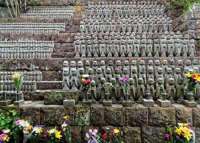 Hundreds of small Jizo statues have been placed around the temple grounds. The god is a guardian of children, especially of those who have died before their parents.