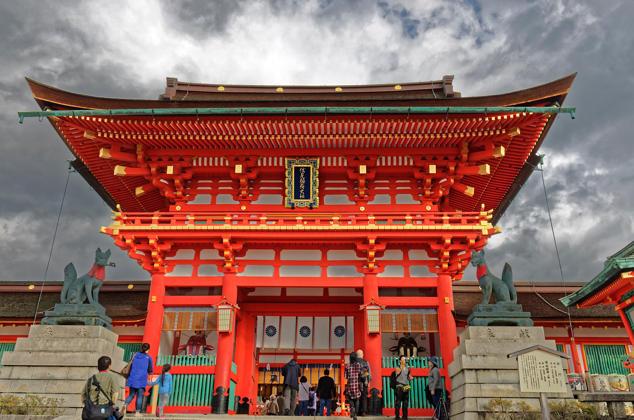 The main shrine, through which one enters the path leading to and through the vast number of <i>torii</i> and on to the inner shrine