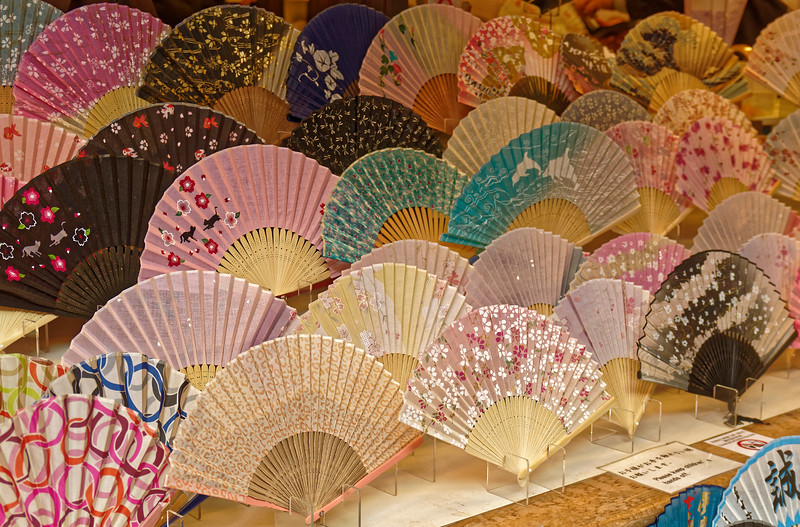 Fans in the window of one of the shops along the street