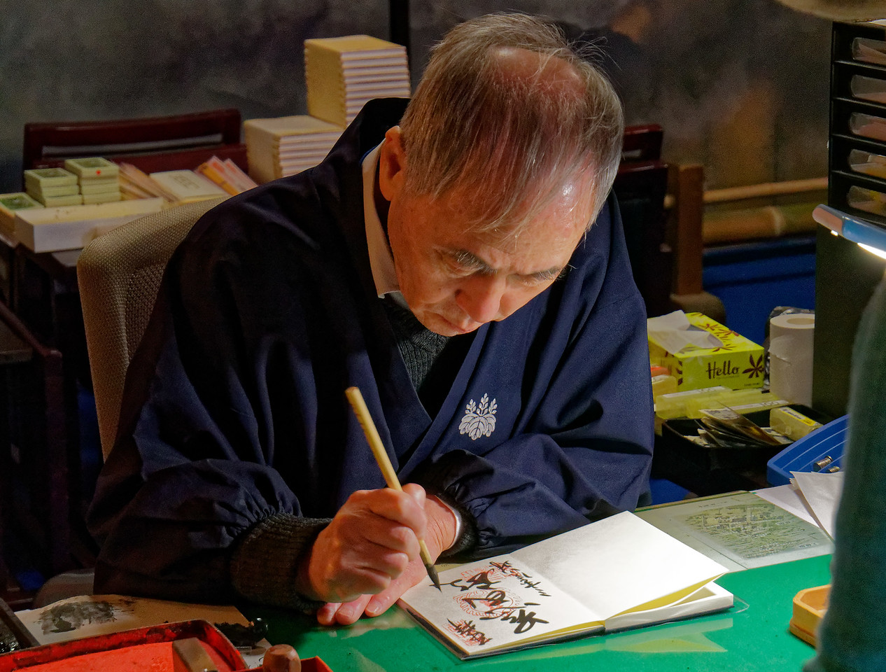 This monk was creating a calligraphic inscription in the book for a visitor.
