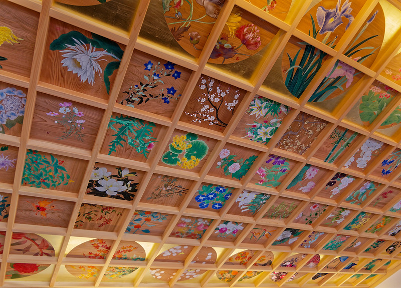 Cheerful paintings of flowers to be seen in the temple's gardens adorn the ceiling of a small coffee house/restaurant within the temple grounds.