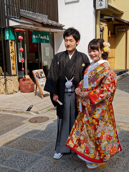 A newly-married couple posing for a portrait near Yasaka Pagoda