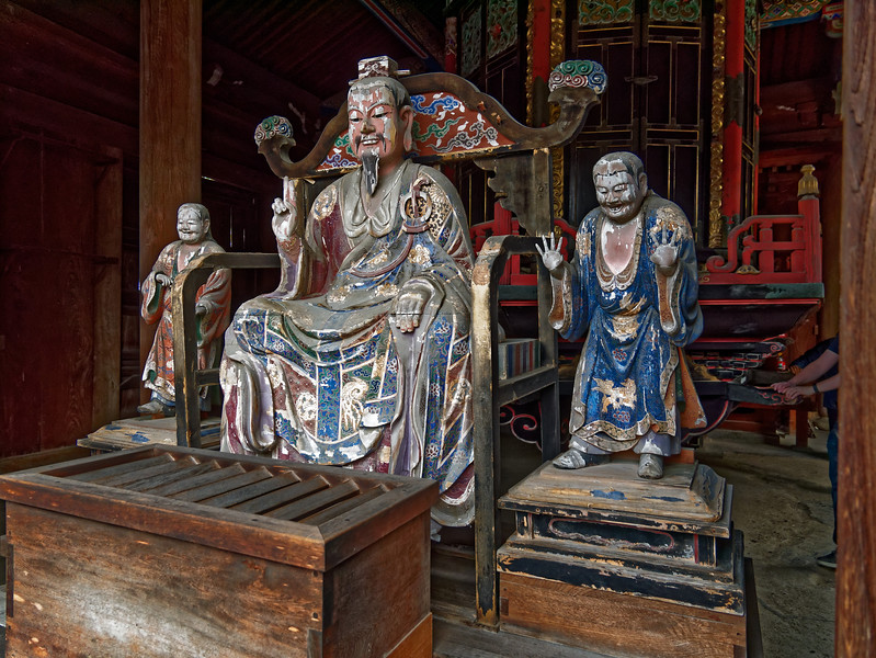 Wooden sculpture of the Chinese Buddhist layman Fu Daishi, Master Fu or Great Teacher Fu, who is said to have invented revolving sutra storage cabinets like that seen in back. He is accompanied by his two sons, Fujou and Fuken (Fucheng and Fujian in Chinese).