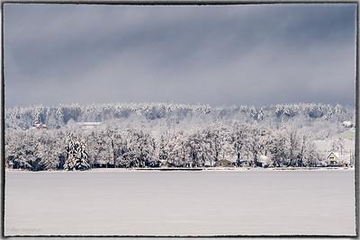 Quebec Shore Across River After a Snowstorm