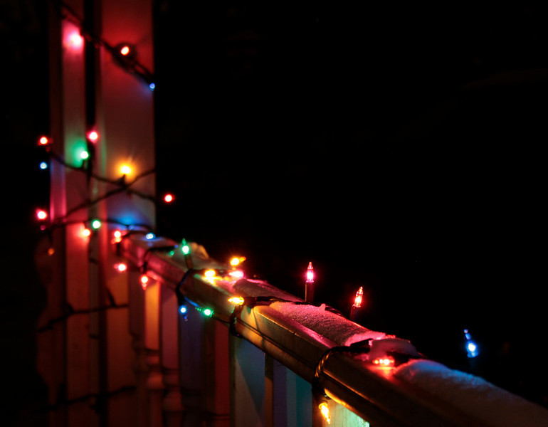 Our Christmas lights on our front porch shortly after a little snow.