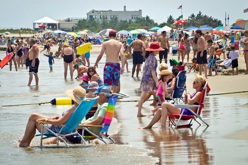 """Relaxing Jersey Shore""<br /> <br /> AVON, NEW JERSEY/USA – JULY 7: Big crowds of sunbathers seek relief from the week long heatwave enjoying the surf on July 7, 2012 at the beach in Avon NJ."