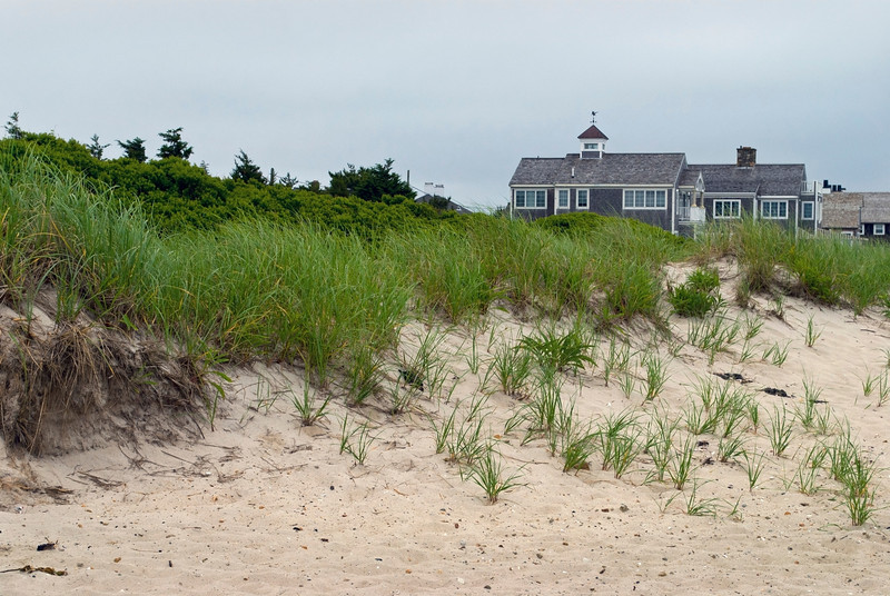 """Cape Cod Homes and Dunes""<br /> <br /> Sand dunes and homes along the beach in Cape Cod, Massachusetts"