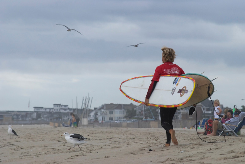 """Surfer Belmar""<br /> A surfer walks along the beach during the Belmar Pro Surf competition in New Jersey."