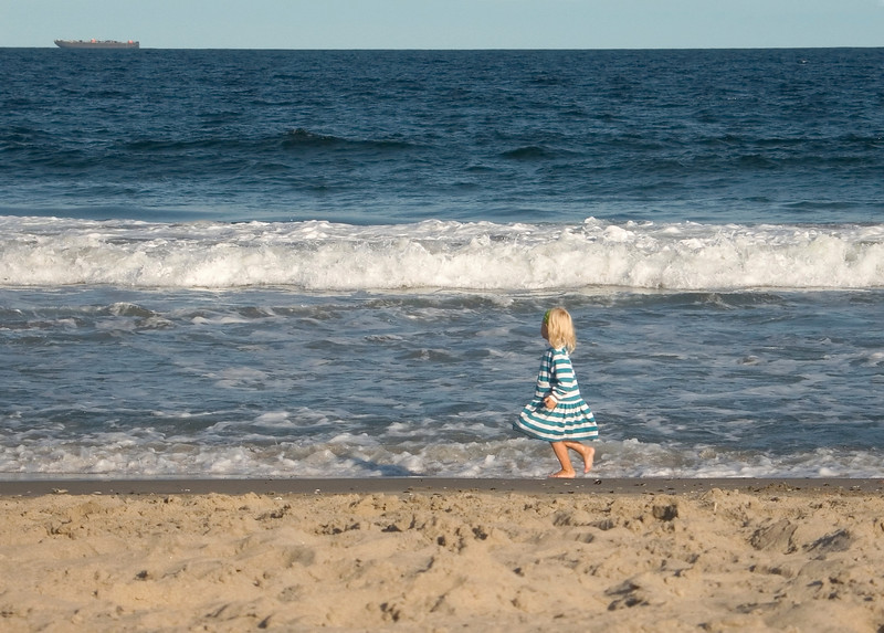"""Stripes""<br /> A child runs along the beach and looks out to sea along the Jersey Shore."