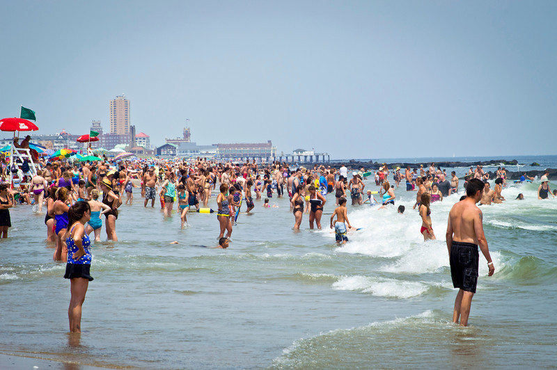"""Summer Relief Jersey Shore""<br /> <br /> AVON, NEW JERSEY/USA – JULY 7: Big crowds of sunbathers seek relief from the week long heatwave enjoying the surf on July 7, 2012 at the beach in Avon NJ."
