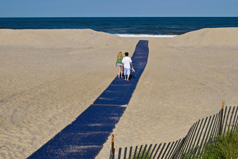 """Beach Walkway""<br /> <br /> A couple walks along the beach walkway in Sea Bright, New Jersey."