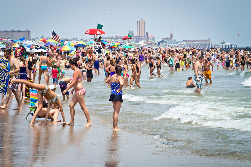 """Cooling Off Jersey Shore""<br /> <br /> AVON, NEW JERSEY/USA – JULY 7: Big crowds of sunbathers seek relief from the week long heatwave enjoying the surf on July 7, 2012 at the beach in Avon NJ."