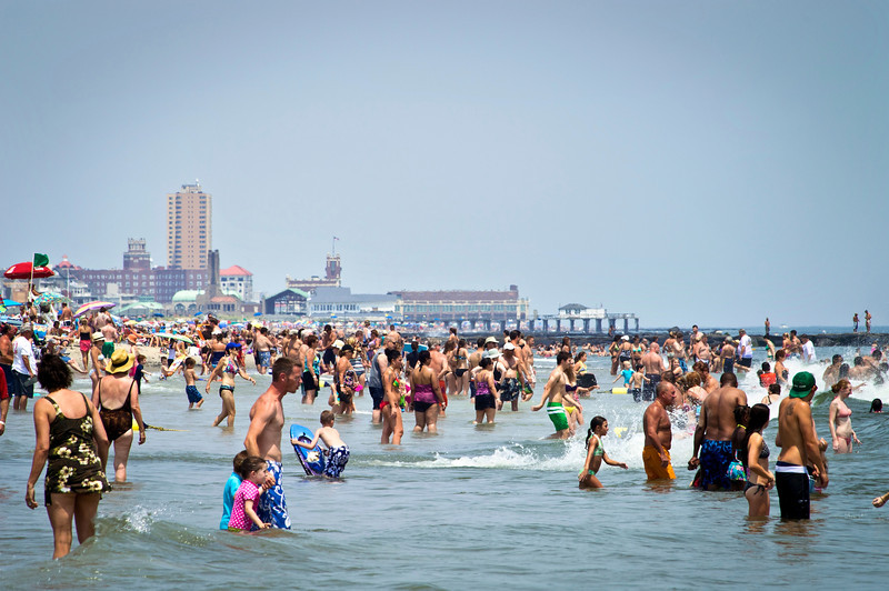 """Beach Crowd Jersey Shore""<br /> <br /> AVON, NEW JERSEY/USA – JULY 7: Big crowds of sunbathers seek relief from the week long heatwave enjoying the surf on July 7, 2012 at the beach in Avon NJ."