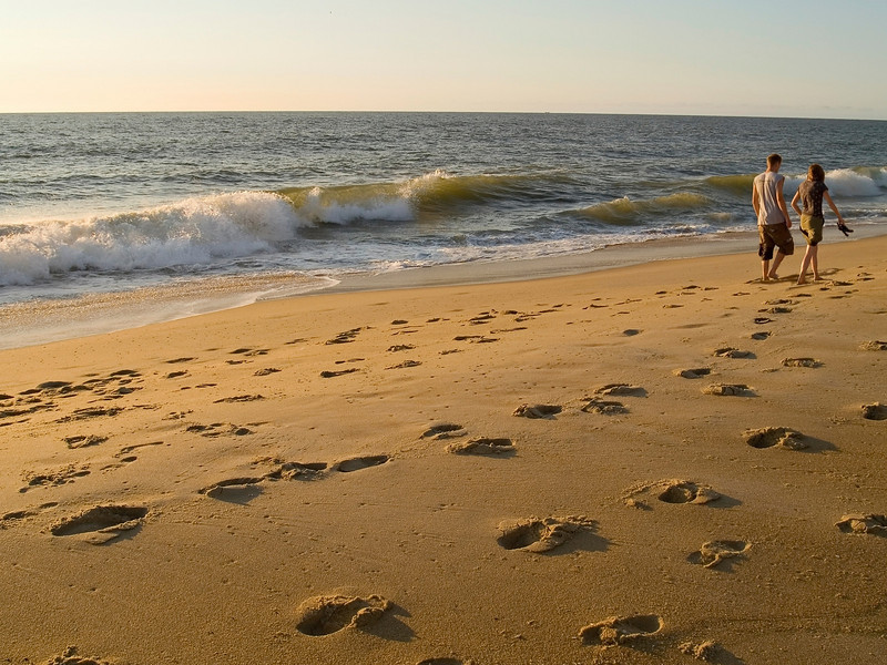 """""""Morning Walk""""<br /> A couple takes a morning stroll on the beach in Ocean City, Maryland."""