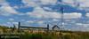 An old wind generator abandoned in a field / Alberta