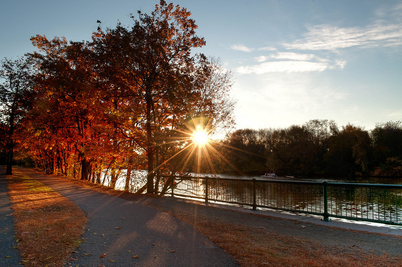 Fall Foliage is illuminated along wit the Charles RIver on Greenough Boulevard in Watertown MA.