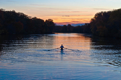 Sunrise and an early morning rower on the Charles RIver in Watertown, MA.